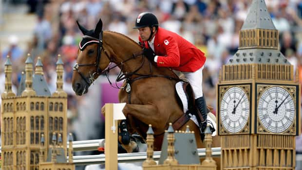 Eric Lamaze of Schomberg, Ont., rides Derly Chin De Muze at the London Olympics on Aug. 8. (David Goldman/Canadian Press)