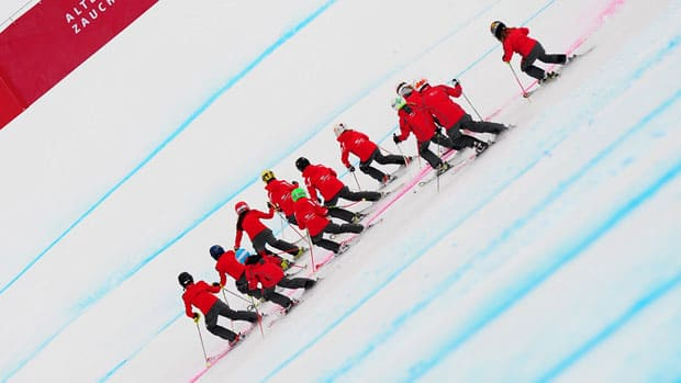 In this Jan. 2011 file photo, children from the Altenmarkt Ski Sports School ski towards the finish after the women's downhill World Cup race in Zauchensee, Austria. (Joe Klamar/AFP/Getty Images)
