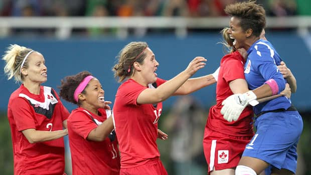 The expression says it all. Canadian goalkeeper Karina Leblanc, right, reacts after making the winning shootout save against Brazil to win the gold medal at the Pan Am Games on Thursday. Celebrating with her from left is Kelly Parker, Desiree Scott, Shannon Woeller and Melanie Booth. (Nathan Denette/Canadian Press)