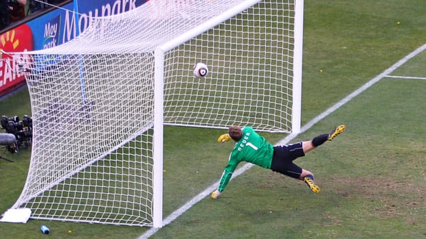 Manuel Neuer of Germany watches the ball bounce over the line from a shot that hit the crossbar from Frank Lampard of England, but the referee judged the ball did not cross the line during the 2010 FIFA World Cup on June 27, 2010 in Bloemfontein, South Africa. (Cameron Spencer/Getty Images)