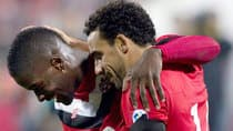 Canada's Tosaint Ricketts, left, celebrates with Dwayne De Rosario after scoring against St. Kitts and Nevis in World Cup qualifying in Toronto on Tuesday. The pair of players represent both the youth and experience on coach Stephen Hart's roster. (Chris Young/Canadian Press)
