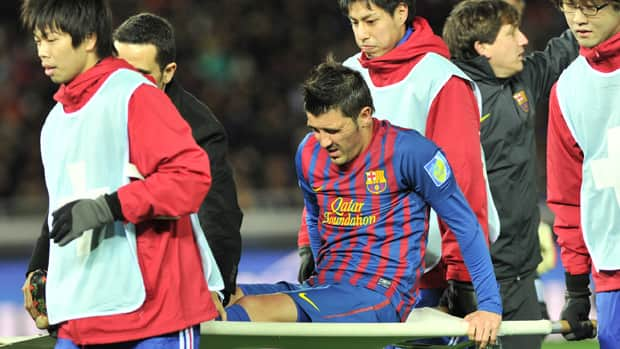 Barcelona player David Villa is stretchered from the field during their semi-final football match against Al Sadd of the Club World Cup in Yokohama on Thursday. Villa faces at least six months out of the game after fracturing his left shin in the first-half of the European champions' Club World Cup semi-final. (Kazuhiro Nogi/AFP/Getty Images)