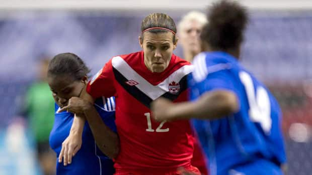 Trying to stop Canadian captain Christine Sinclair is a unenviable task as Haiti's Wisline Dolce, left, and Samantha Marie-Ann Brand, right, found out during the group stage of the CONCACAF Olympic women's qualifying tournament in Vancouver. (Jonathan Hayward/Canadian Press)