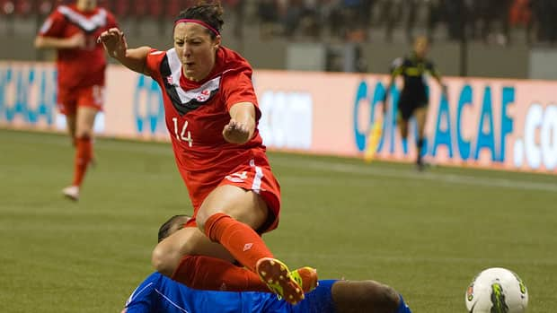 Canadian striker Melissa Tancredi gets tripped up by Haiti's Carmela Aristide during Canada's 6-0 win Thursday night at the CONCACAF Olympic women's qualifying tournament in Vancouver.