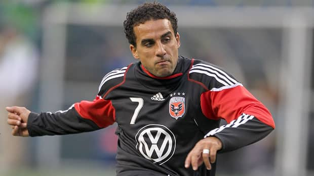Canadian international and D.C. United star Dwayne De Rosario is glad to plant roots with D.C. United, where he recently signed a lucrative multi-year deal. (Otto Greule Jr/Getty Images)