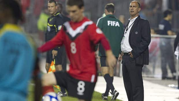 Canada's coach Stephen Hart watches from the touchline during second half 2014 World Cup qualifying game action on Sept. 2, 2011. Hart has faced challenges this year when trying to piece together rosters for crucial FIFA friendlies. (Chris Young/Canadian Press)