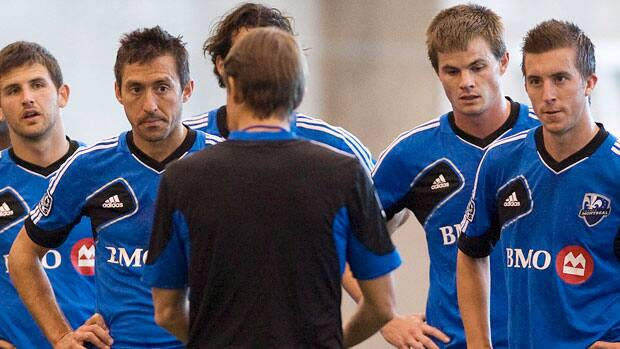 Montreal Impact's Davy Arnaud, 2nd left, listens to head coach Jesse Marsch, as he talks with players during a training session in Montreal on Tuesday. The Impact will play their first game as an MLS team in Vancouver on Saturday. (Graham Hughes/The Canadian Press)