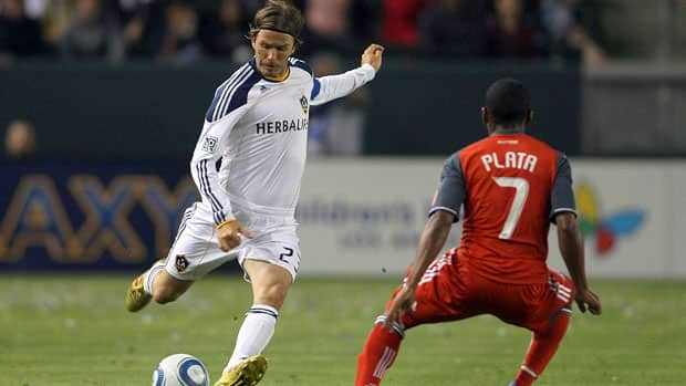 David Beckham of the Los Angeles Galaxy crosses the ball as Toronto FC's Joao Plata looks on during MLS action last season. The two teams face off Wednesday night at Rogers Centre in Toronto in the first leg of the CONCACAF Champions League quarter-finals.  (Victor Decolongon/Getty Images)