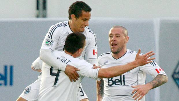 Vancouver Whitecaps FC's Alain Rochat, left, along with teammates Camilo Sanvezzo and Eric Hassli during their inaugural MLS season. (Jeff Vinnick/Getty Images)