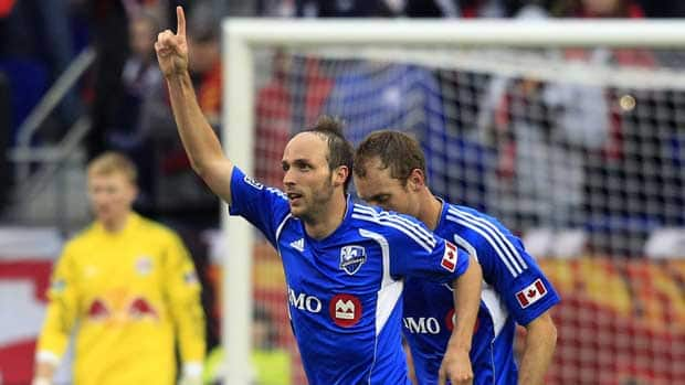 Montreal Impact's Justin Mapp, front, celebrates his goal during the first half against the New York Red Bulls on Saturday, March 31. (Mel Evans/Associated Press)