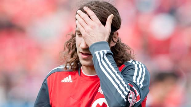 TFC's Torsten Frings tossed away the captain's armband on Saturday, clearly frustrated at picking up another injury so soon after recovering from the last. (Chris Young/Canadian Press)