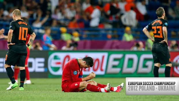 Portugal's Cristiano Ronaldo clenches his fists at the end of the Euro 2012 soccer championship Group B match between Portugal and the Netherlands in Kharkiv, Ukraine on Sunday. (Armando Franca/Associated Press)