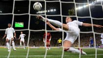 John Terry of England clears an effort from Marko Devic of Ukraine off the line on Tuesday in Euro Cup action. (Laurence Griffiths/Getty Images)