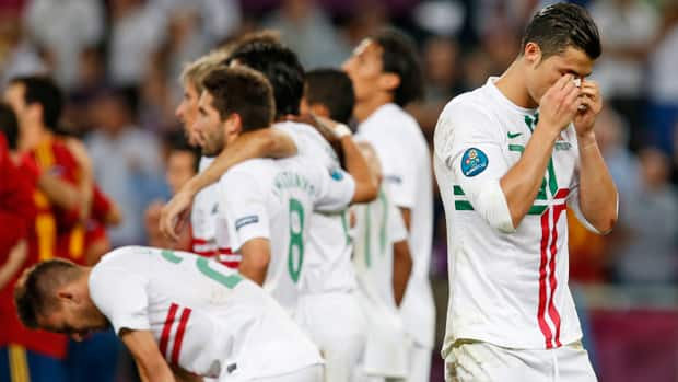 Portugal's Cristiano Ronaldo, right, and some other teammates react with disbelief after falling to Spain in a shootout at the Euro 2012 semifinal Wednesday in Donetsk, Ukraine. (Armando Franca/Associated Press)