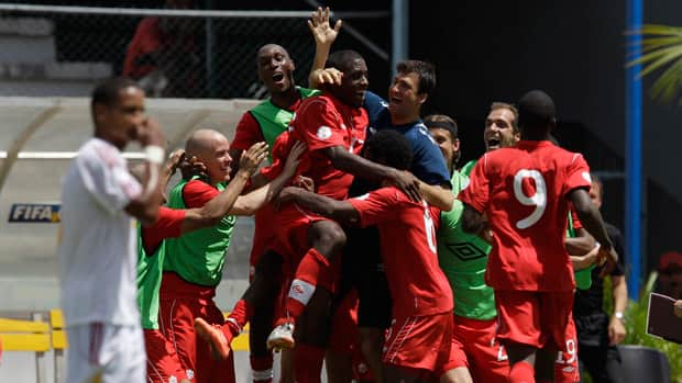 Canada's players celebrate after Olivier Occean scored against Cuba during the 2014 World Cup qualifying soccer game in Havana, Cuba, Friday June 8, 2012. (AP Photo/Franklin Reyes)