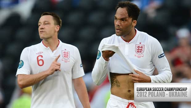 English defenders Joleon Lescott, right, and John Terry during the Euro 2012 match against France on June 11, 2012 at the Donbass Arena in Donetsk. (Franck Fife/AFP/GettyImages)