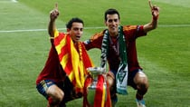 Spain's Xavi, left, and Sergio Busquets pose with the European championship trophy on Sunday in Kiev. (Matthias Schrader/Associated Press)