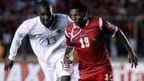 Canada's Atiba Hutchinson (13) chases down Jean Carlos Cedeno in a 2-0 loss to Panama in Tuesday's World Cup qualifier. (Arnulfo Franco/Associated Press)