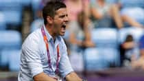 With the women's World Cup in sight, Canadian coach John Herdman isn't resting on his players' Olympics success. (Hussein Malla/Associated Press)