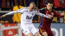 Whitecaps forward Kenny Miller, left, competes with Real Salt Lake midfielder Will Johnson in a scoreless draw on Saturday. (Kim Raff/Canadian Press)