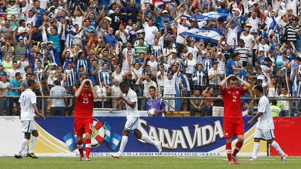 Canadian players Edgar David, left, and Ledgerwood Nikolas, react during their crushing loss to Honduras in their final 2014 World Cup qualifying soccer match Tuesday. (Esteban Felix/Associated Press)