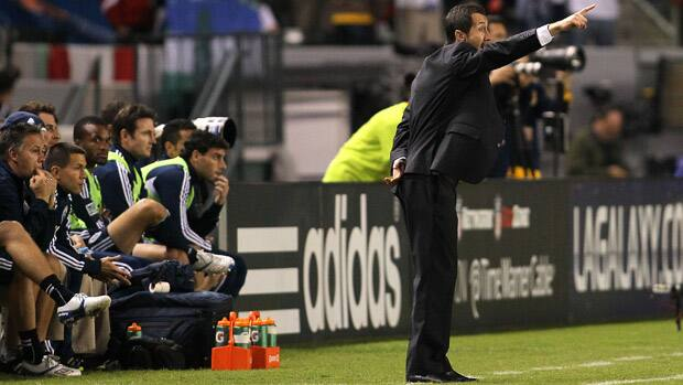 Vancouver Whitecaps head coach Martin Rennie yells instructions to his players from the bench area during their playoff game against the Los Angeles Galaxy on Thursday. (Victor Decolongon/Getty Images)