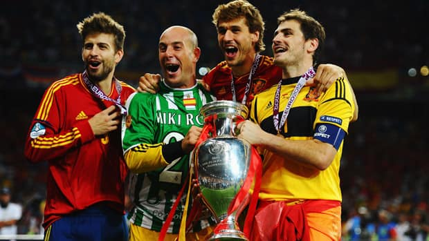 Gerard Pique, Pepe Reina, Fernando Llorente and Iker Casillas of Spain celebrate with the trophy following victory in the EURO 2012 final against Italy this past summer. (Laurence Griffiths/Getty Images)