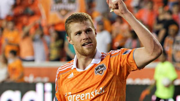 Andre Hainault, acknowledges the Houston fans after the Dynamo victory in the first leg of the MLS East final against D.C. United. (Bob Levey/Getty Images)