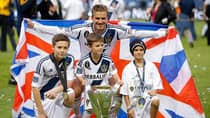 David Beckham poses with his sons, from left, Brooklyn, Romeo and Cruz after the Los Angeles Galaxy's 3-1 win in the MLS Cup championship soccer match against Houston on Dec. 1. (Jae C. Hong/Associated Press)