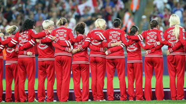 Members of the Canadian women's soccer team get ready to receive their bronze medals at the London Olympics. (Ronald Martinez/Getty Images)