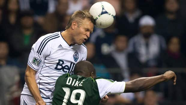 Vancouver captain Jay DeMerit, top, led the Whitecaps to an MLS playoff appearance in 2012 -- the first ever by a Canadian-based club. (Darryl Dyck/Canadian Press)