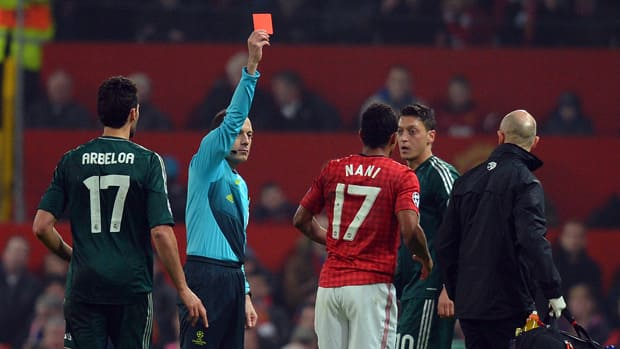 Referee shows Manchester United midfielder Nani the red card during the UEFA Champions League round match against Real Madrid at Old Trafford in Manchester, England. (Andrew Yates/AFP/Getty Images)