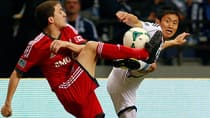 Hogan Ephraim, left, of Toronto FC and Young-Pyo Lee of the Whitecaps FC battle for the soccer ball at BC Place on March 2. (Jeff Vinnick/Getty Images)