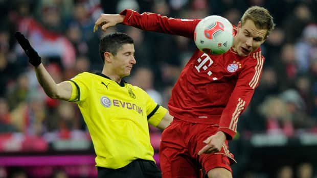 Dortmund's Robert Lewandowski, left, fought for the ball with Bayern's Holger Badstuber during a matchup of the eventual Champions League finalists in a German league game in December. (Lennart Preiss/Bongarts/Getty Images)