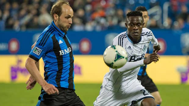 The Impact's Justin Mapp, left, and the Whitecaps' Gershon Koffie helped their teams battle to a scoreless draw in the first leg of the Canadian Championship final on May 15 in Montreal. (Graham Hughes/Canadian Press)