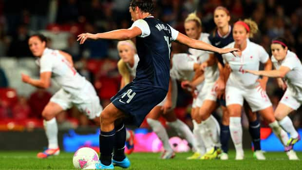 The Canadian and U.S. women's soccer teams are set to meet for the first time since their classic encounter at the London Olympics, where Abby Wambach's penalty kick helped send the U.S. to a controversial semifinal win. (Stanley Chou/Getty Images)