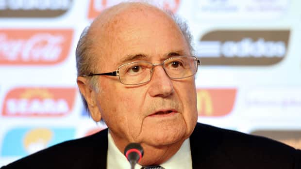 Despite FIFA President Sepp Blatter's rosy view of things, there is a clear divide growing between what is going on at the Confederations Cup, and what is actually taking place in the streets of Brazil. (Vincenzo Pinto/Getty Images)