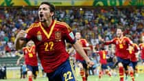 Spain's Jesus Navas celebrates after scoring the winning penalty kick against Italy during the semfinal of the Confederations Cup on Thursday Fortaleza, Brazil. (Eugene Hoshiko/Associated Press)
