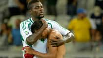 An unidentified Tahiti player, right, is comforted by Nigeria's John Ogu, left, after Nigeria won 6-1 in the Confederations Cup Group B match Monday in Belo Horizonte, Brazil. (Eugenio Savio)
