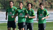 Left to right, Brazil players Fred, Neymar, Marcelo and Oscar jog during a training session in Belo Horizonte, Brazil on June 24, 2013. (Vanderlei Almeida/AFP/Getty Images)