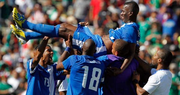 Martinique players celebrate with midfielder Fabrice Reuperne after he scored in extra time to defeat Canada 1-0 in a CONCACAF Gold Cup soccer match on Sunday. It was one of the most embarassing defeats in Canadian soccer history. (Alex Gallardo/Associated Press)