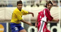 Brazil's Ramon, left, and Nick Dasovic of Canada concentrate on the ball during their Confederations Cup match at Kashima Soccer Stadium in Kashima, northeast of Tokyo, Saturday, June 2, 2001. The match ended a 0-0 tie. (AP Photo/Koji Sasahara)