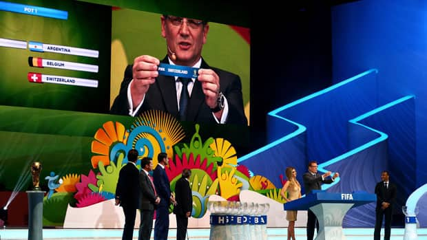 FIFA Secretary General Jerome Valcke holds up the name of Switzerland during the final draw for the 2014 FIFA World Cup at Costa do Sauipe Resort on Friday in Costa do Sauipe, Bahia, Brazil. (Clive Mason/Getty Images)