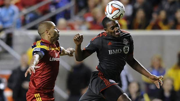 Doneil Henry, right, and Toronto FC were handed their first defeat of the season by Alvaro Saborio and Real Salt Lake. (Matt Gade/Deseret News/Associated Press)