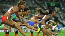 Canadian hurdler Phylicia George, far left, says that being able to focus on training full-time helps her keep pace with the competition. (Jung Yeon-Je/AFP/Getty Images)