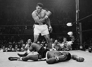 Ali celebrates after beating Sonny Liston in 1964. (Getty Images)