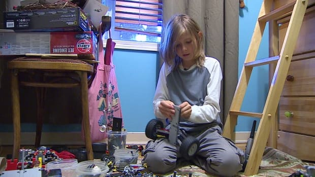 Tadhg Dunlup plays with lego at home. The 11-year-old was detained at a LEGO store in Calgary because he was shopping alone at his favourite store.