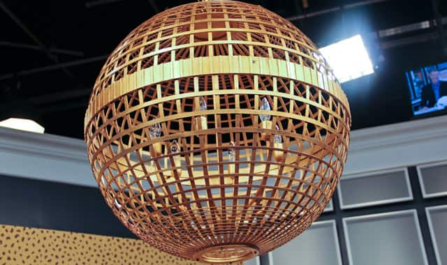 Gold pendant light hangs from ceiling.