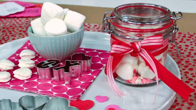 Marshmallows cut into hearts and placed in a glass jar for a valentines day gift.