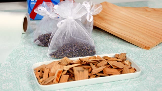 Use little pouches of lavender or cedar chips to stave off insects when storing winter clothes